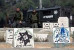 criminal soldiers at the Palestinian Muslim cemetery which desecrating by the criminal American settlers in Hebron