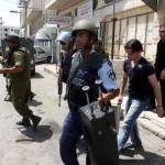 Israeli soldiers and police looting Radio Al-Majed in Hebron (Credit - Tariq Al-Kayal)