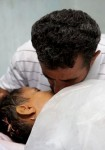 Husam Yousef Musa, giving the last kiss his to child.