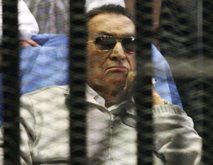 File photo of Egypt's ousted President Mubarak sitting inside a dock at the police academy