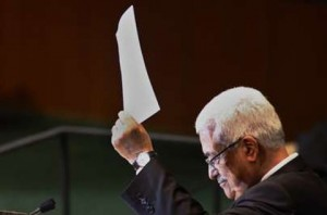 Palestinian Authority president Mahmoud Abbas holds up a letter to United Nations Secretary General Ban Ki-Moon requesting Palestinian statehood at the 66th United Nations General Assembly at U.N. headquarters in New York