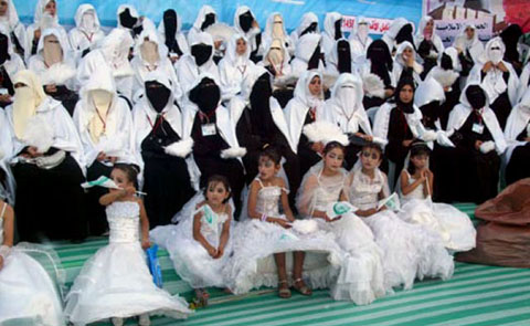A group of brides in a mass wedding ceremony held by the Islamic Charity at the stadium in Rafah on August 4 2010. Covering women like this is a new and was not known to Palestine throughout history. Pic. Credit: Al-Quds newspaper, Jerusalem
